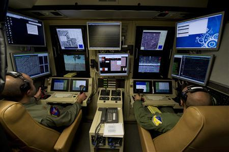 Drone operators fly an MQ-9 Reaper training mission from a ground control station at Holloman Air Force Base, New Mexico, in this U.S. Air Force handout photo taken October 3, 2012. REUTERS/Airman 1st Class Michael Shoemaker/USAF/Handout